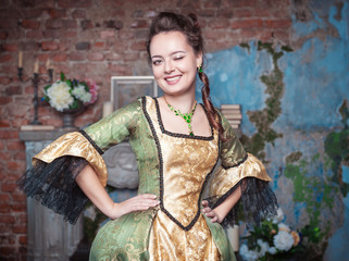 Beautiful woman in medieval dress winking