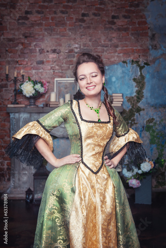 Beautiful woman in medieval dress winking
