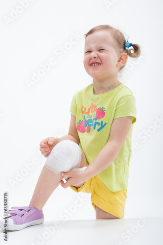 Little girl with bandage on knee