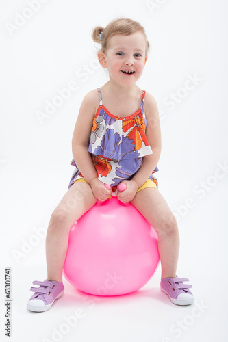 Little girl jumping on gym ball