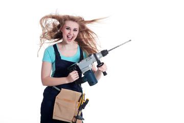 Junge Frau mit Bohrmaschine