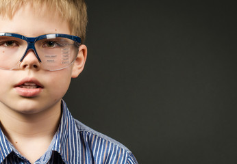 Picture of cute boy in digital glasses.