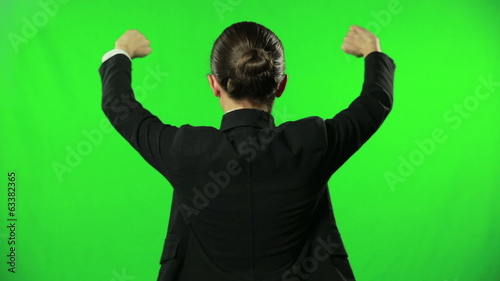 Young woman opening something against green screen