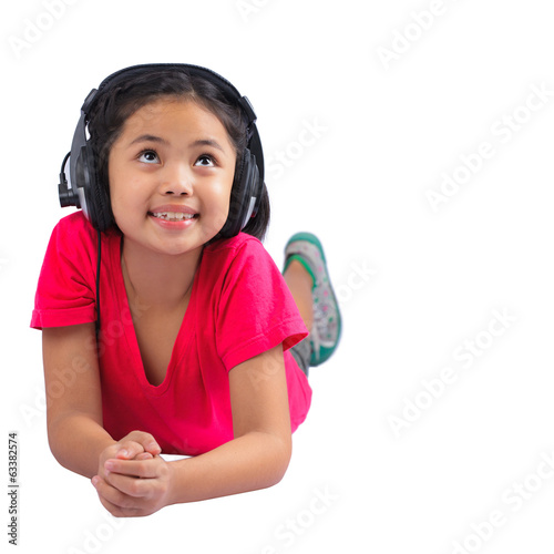 Little girl is enjoying music