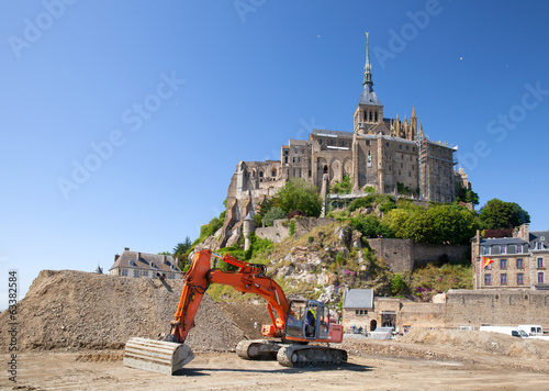 The excavator near from Mont Saint Michel, Normandy, France