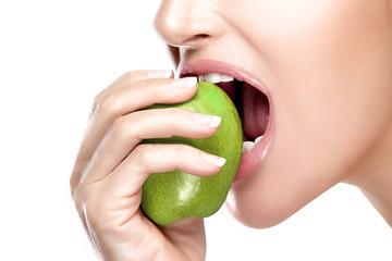 Beautiful Healthy Mouth Biting a Big Green Apple