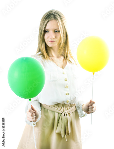 The girl with a yellow and green ball