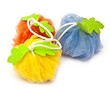 colorful soft bath puffs on white background