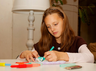 little girl painting at home