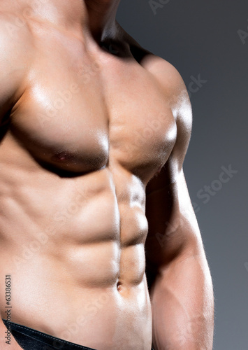 Muscular body of young sexy man.