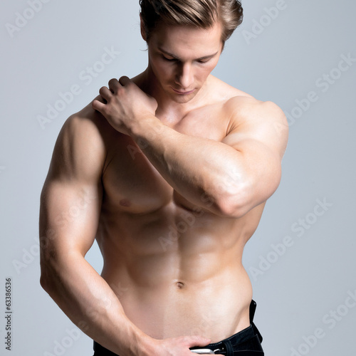 Handsome man with sexy muscular beautiful body.