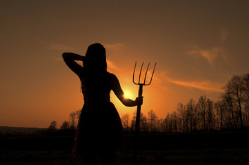 Woman holding hay fork