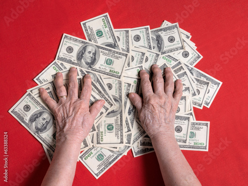 Old woman's hands and dollar
