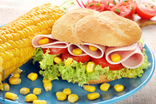 Sandwich with ham and tomatoes and sweetcorn