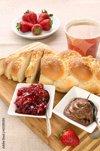 Sweet bread with cherry jam, and chocolate. Continental breakfas