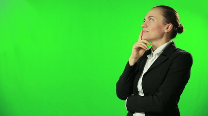 Portrait of a thinking businesswoman against a green screen