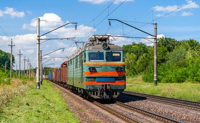 Electric locomotive hauling a cargo train