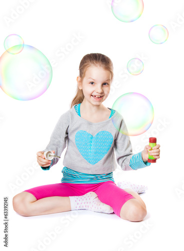 happy little girl with soap bubbles