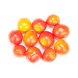 Red tomatoes on white background.