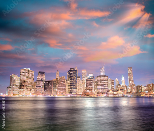 Stunning sunset in New York City. Lower Manhattan night skyline