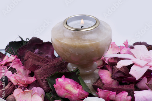 Old marble candlestick with flowers around it (feng shui)