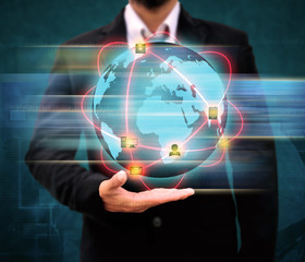 Businessman holding world Technology