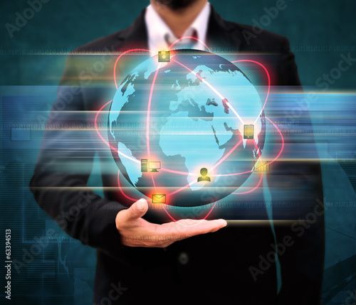 Businessman holding world Technology