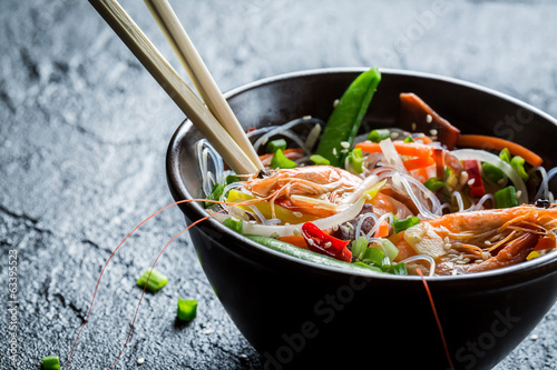 Shrimp and vegetables served with noodles