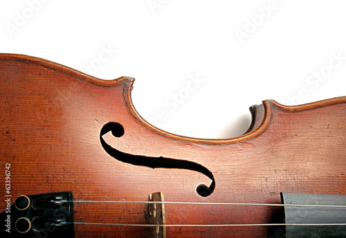 Old scratched violin on white background