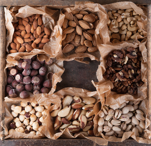 Collection of nuts in a wooden box.