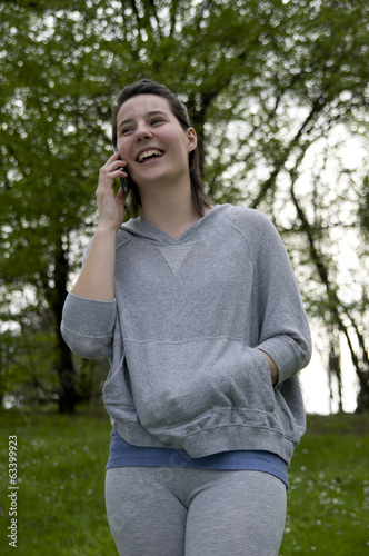 A beautiful young girl call at phone