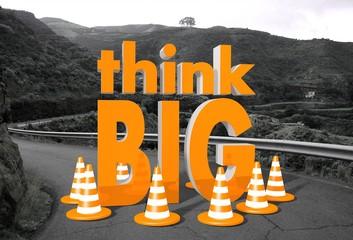 think big symbol on a road