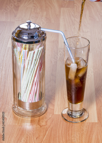 Cola Ice and straws make a nice cold drink