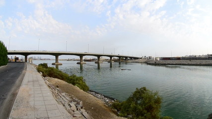 bridge over sea and sidewalk in jeddah downtown waterfront