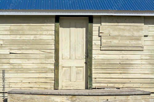 Rustic old porch with wooden door