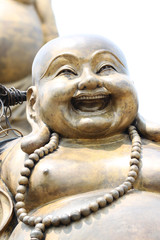Statues of Chinese deity in smiling.