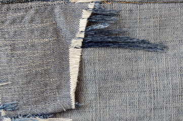 close up ragged fabric of old bluejeans