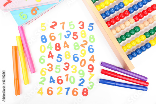 Colorful numbers, markers and abacus, isolated on white