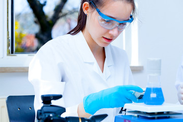 girl laboratory assistant checks samples in a medical lab