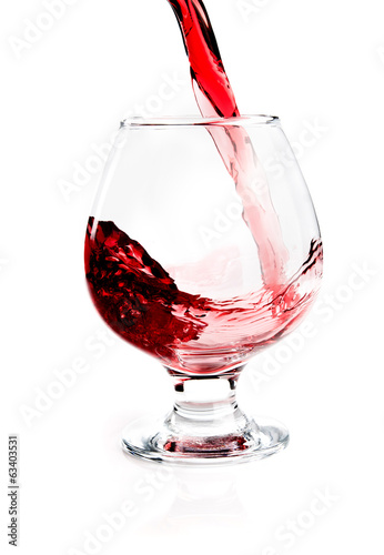 Glass with flowing wine