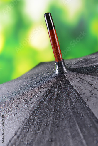 Black Umbrella on bright background