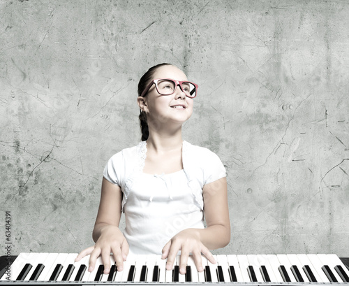 School girl with piano