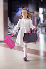 Cute little girl goes to the mall.