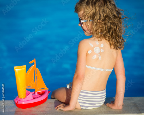 Sunscreen lotion sun drawing on childrens back