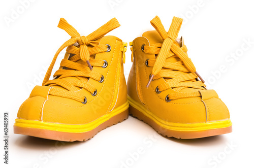 pair of orang shoes for kid on white background