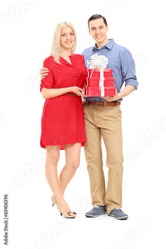 Couple holding presents