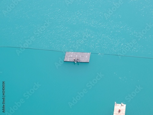 blue water with bathing platform