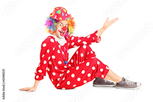 Male clown gesturing with hand