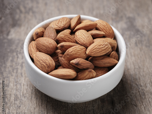 white bowl full of almonds