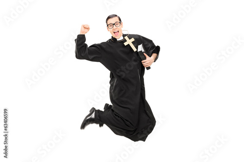 Excited male priest jumping with joy